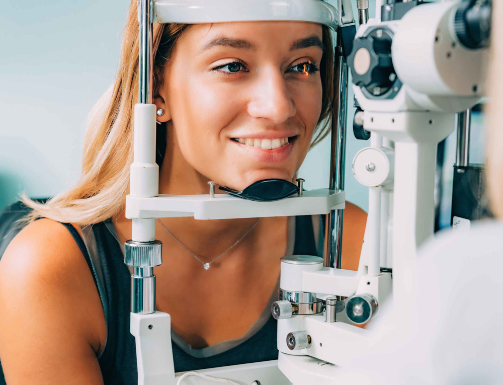 blonde woman getting eye exam