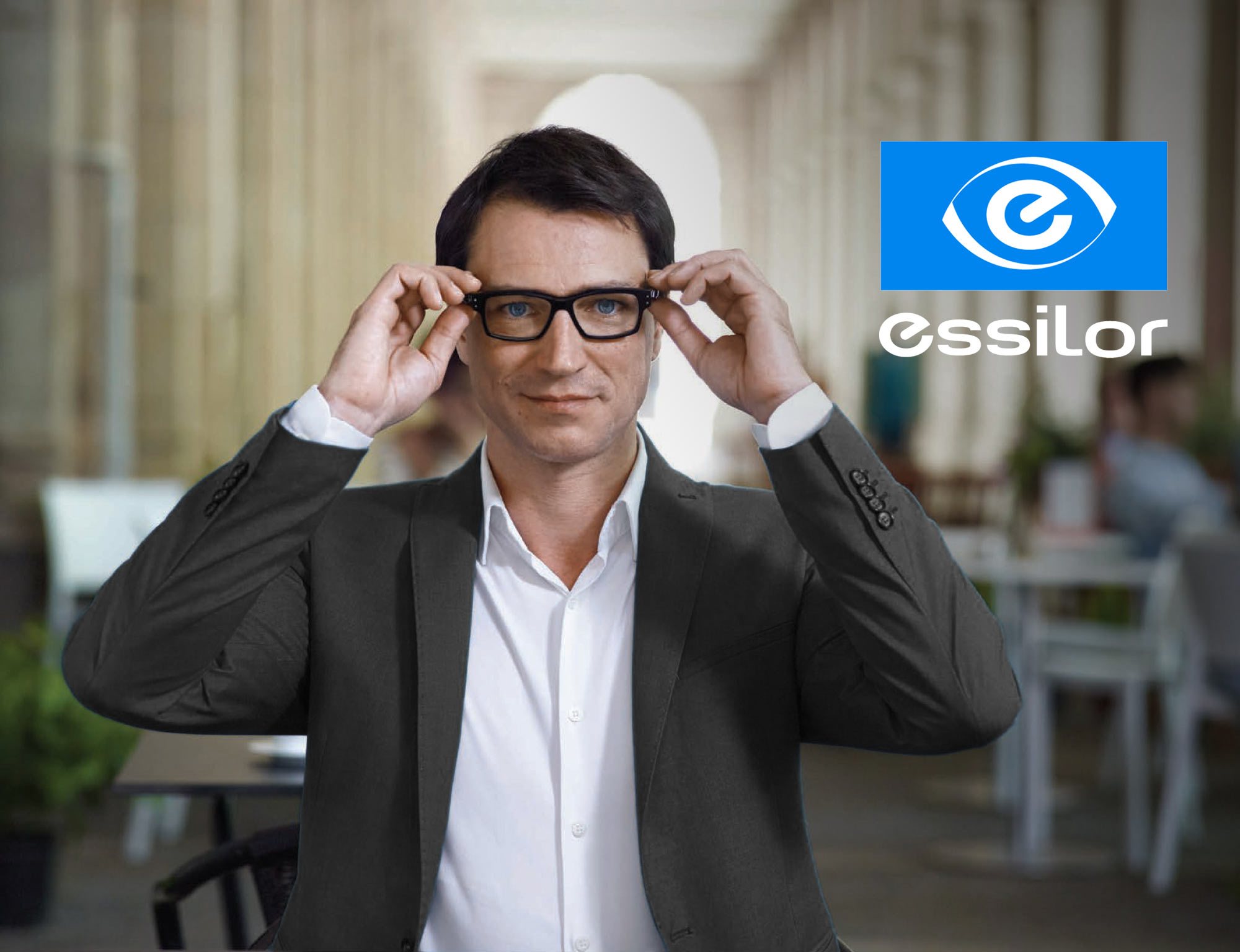 man in suit wearing essilor